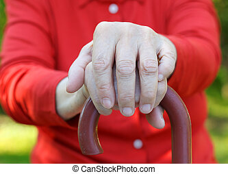 Elderly hands - Close up of an elderly hand holding a cane