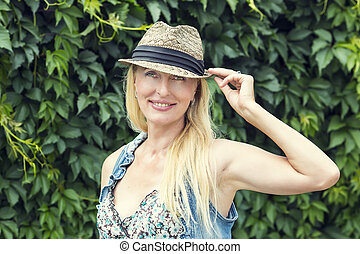 Portrait of an adult woman in nature summer