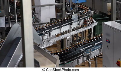 Plastic water bottles on conveyor or water bottling machine...