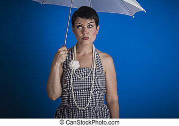 Joyless, pinup girl style of the 50s with a white umbrella