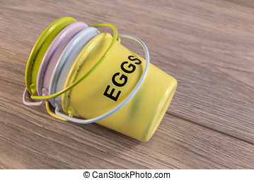 Egg cups shown lying on a wooden background
