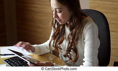 beautiful young woman in office - beautiful young woman in a...