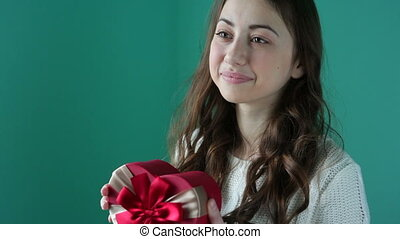 Valentine Day concept. Beautiful young smiling woman with a...