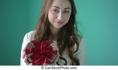 Valentine Day concept Beautiful young smiling woman with a...