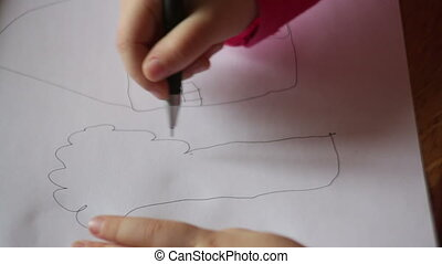 hand of a little girl draws a tree on paper
