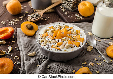 Domestic apricots musli yogurt with milk and crispy nuts and...