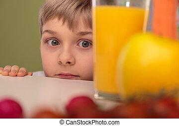 Afraid of healthy food - Scared little boy afraid of healthy...