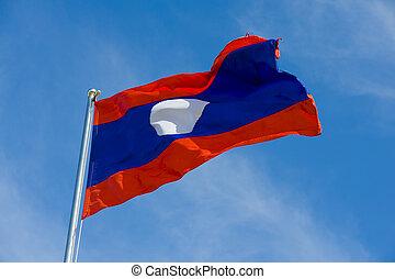 laotian flag on a pole against blue sky