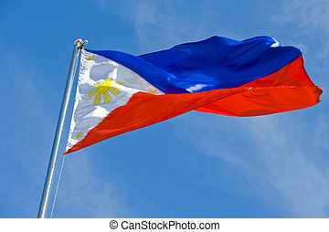philippine flag on a pole against blue sky