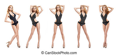 Young and sporty fashion model posing in a swimsuit isolated...