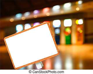 blank blackboard on abstract blurry automatic teller machine or ATM in dim light building