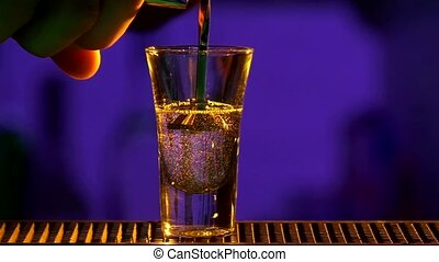 Barman pouring clear alcohol liquid with splash, cloudy, into a glass, shots, slow motion, close up