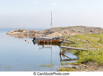 Wooden sailboat and small bridges in the archipelago