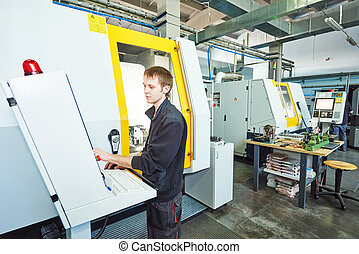 worker at tool workshop - mechanical industrial worker at...