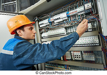 electrician work - electrician with screwdriver tighten up...