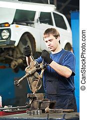 auto mechanic at work with wrench spanner - automotive...
