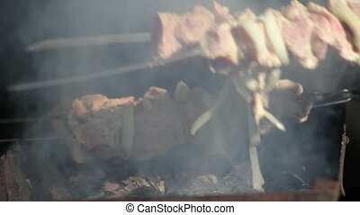 Meat grilled on the fire.