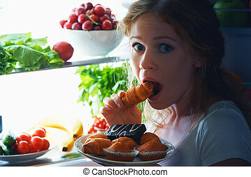 Woman eats night stole the refrigerator - woman eats sweets...
