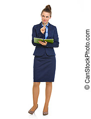 Elegant businesswoman holding notebook with pen on chin -...