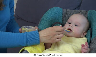 woman feeds baby girl
