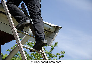 Person on ladder with clogs - Person with clogs climbs up to...