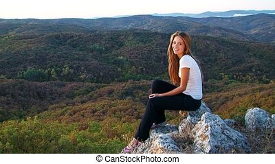 Pretty Model Sitting On The Rock