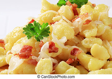 Small potato dumplings (halushky) with bacon and cabbage