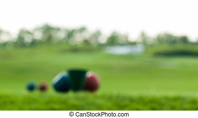 Close-up of golf stuff on field - Great play Fade in and...