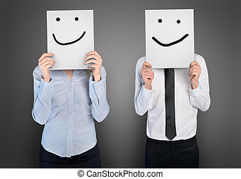 Smile shape on paper in ahnds of business womana nd man