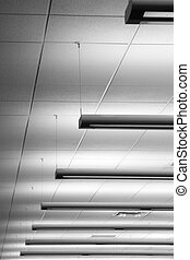 Fluorescent lighting - Row of fluorescent lights in an...