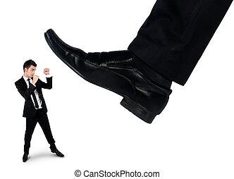 Feet man crushing little business man
