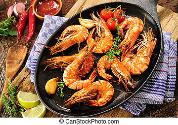 Fried shrimps - Fried king prawns on iron pan
