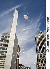 Baloons in the city - White balloons released simultaneously...