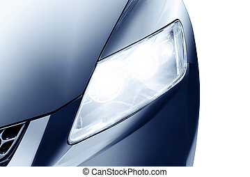 Car headlight - Predatory car headlight and hood of powerful...