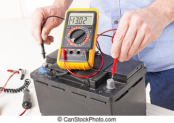 Checking car battery - Testing car battery with digital...