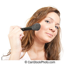 Girl putting facial powder  with a brush