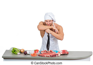 chef bodybuilder preparing large chunks of raw meat -...