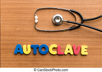 Autoclave colorful word with Stethoscope on wooden...