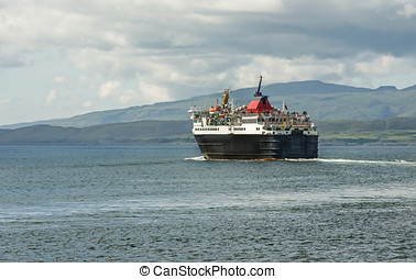 Ferry boat going across the sea in Oban, Scotland