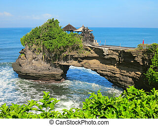 Ocean rock near Pura Batu Bolong temple, Bali, Indonesia -...