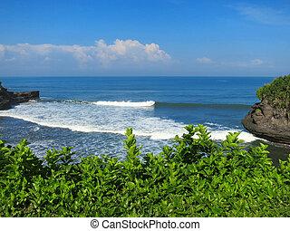 Ocean bay near Pura Batu Bolong temple, Bali, Indonesia -...