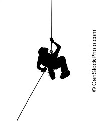 Silhouette of Person Abseiling - A male climber rappels...
