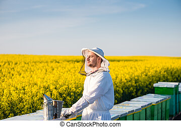 Young proud apiarist - Proud apiarist, on the rapeseed...