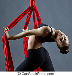 Aerial silks dance. Sensual young dancer posing at camera