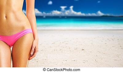 Woman on beautiful beach at Seychelles, Praslin, Anse Lazio....