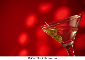 Vodka and red - Vodka and olives on a red background