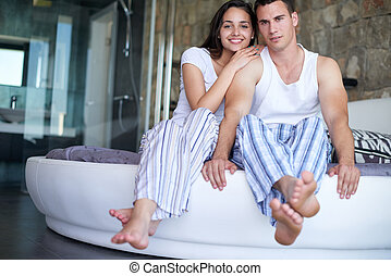 couple relax and have fun in bed - happy young couple relax...
