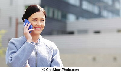 young smiling businesswoman calling on smartphone -...