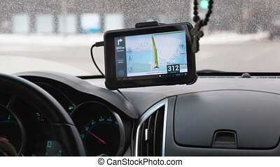 Driving a car with GPS device over dashboard - Close-up shot...