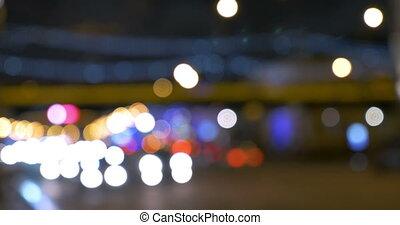 Blurred lights of city traffic at night - Defocus of road...
